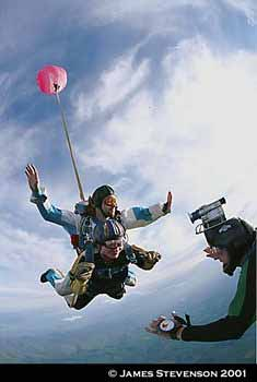 Tandem Skydive being filmed as chute opens